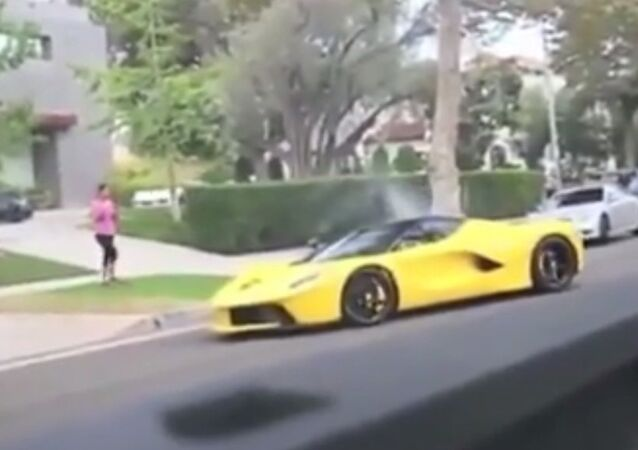 Ferrari owned by Qatari sheikh racing through quiet residential Beverly Hills neighborhood.