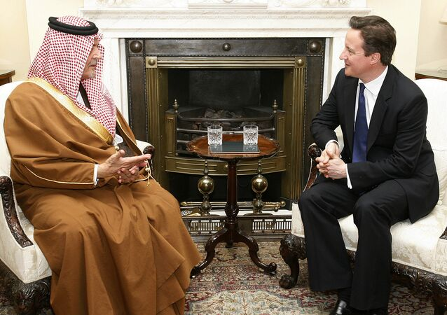 Britain's Prime Minister David Cameron, right, meets with Saudi Arabia's Foreign Minister Prince Saud Al Faisal.