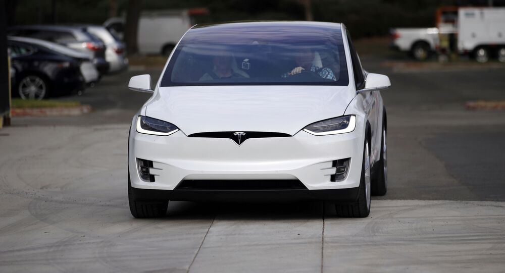 The Tesla Model X car is test driven at the company's headquarters, September 29, 2015, in Fremont, California