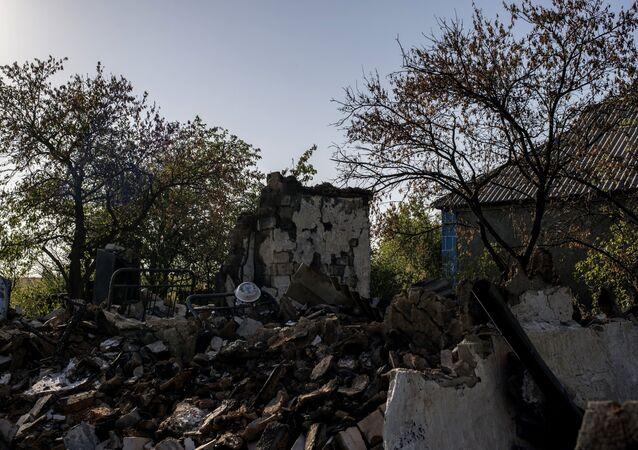 Destroyed houses in Lugansk Region