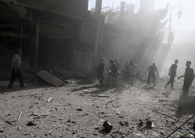 Civil defence members move an injured man on a stretcher after what activists said was an airstrike by forces loyal to Syria's President Bashar al-Assad on the town of Douma, eastern Ghouta of Damascus September 19, 2015