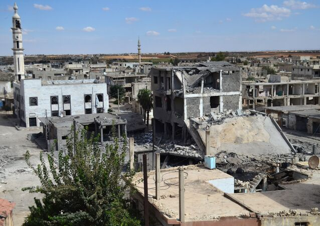 A picture taken on September 30, 2015 shows a general view of deserted streets and damaged buildings in the central Syrian town of Talbisseh in the Homs province