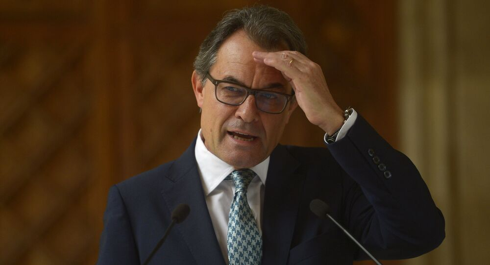 In this Tuesday, Oct. 14, 2014 file photo, Catalonia's regional president Artur Mas gestures during a press conference at the Generalitat Palace in Barcelona, Spain. Catalonia's acting regional president has been placed under investigation by a court for his role in staging a referendum on independence last year, officials said Tuesday Sept 29, 2015