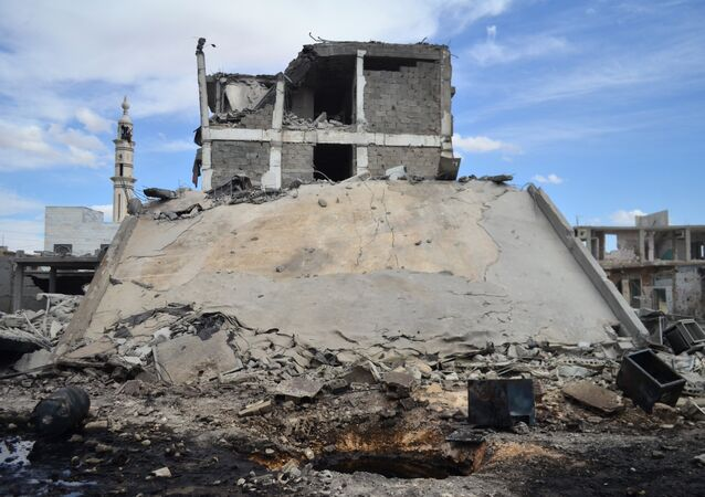 A picture taken on September 30, 2015 shows damaged buildings and a minaret in the central Syrian town of Talbisseh in the Homs province. Russian warplanes carried out air strikes in three Syrian provinces, including Homs, along with regime aircraft on September 30, according to a Syrian security source