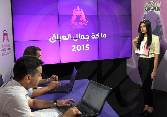 An applicant being interviewed at the auditions of Miss Iraq at Al-Mada TV studios in Baghdad