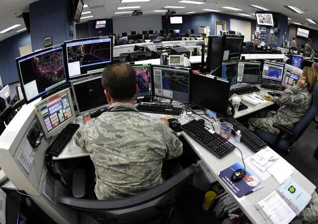 Air National Guard soldiers monitor computer screens