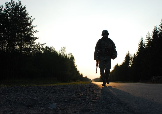 U.S. Army Cpl. Mihai Mocanu of Bravo Company, 2nd Battalion, 6th Infantry Regiment, performs a ruck march during the United States Army Europe Soldier and NCO of the Year Competition Aug. 15, 2007, at the Grafenwoehr Training Area in Germany.
