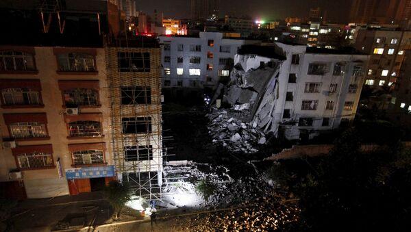 A damaged building is seen after explosions hit Liucheng, Guangxi Zhuang Autonomous Region - Sputnik International