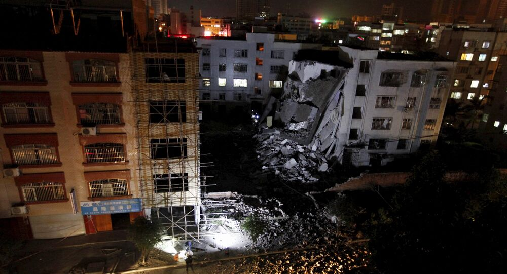 A damaged building is seen after explosions hit Liucheng, Guangxi Zhuang Autonomous Region
