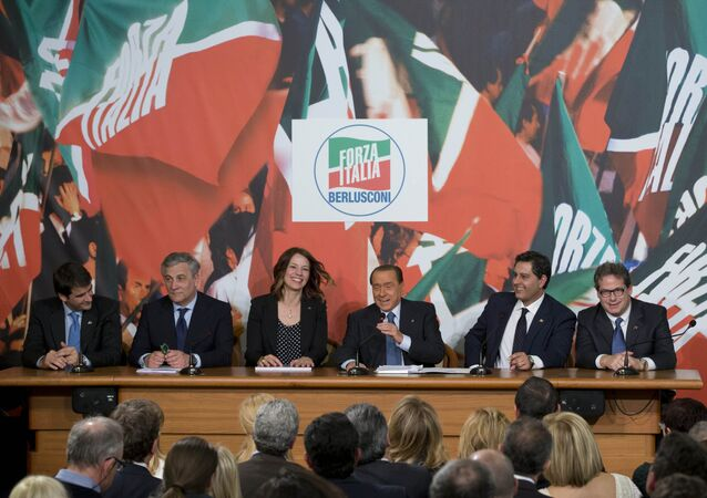 Italian former Premier and Forza Italia, Go Italy, party leader Silvio Berlusconi, third from right, and his party's candidates for the upcoming European Parliament elections, from left, Raffaele Fitto, Antonio Tajani, Elisabetta Gardini, Giovanni Toti and Gianfranco Micciche', meet the journalists during a press conference, in Rome