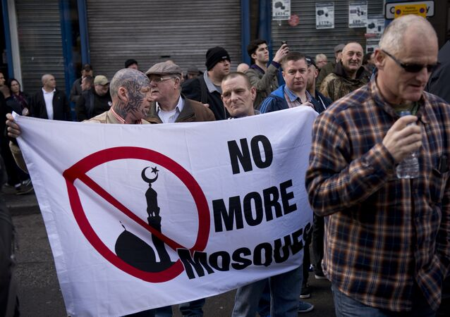 Protesters hold a banner reading 'No more mosque'