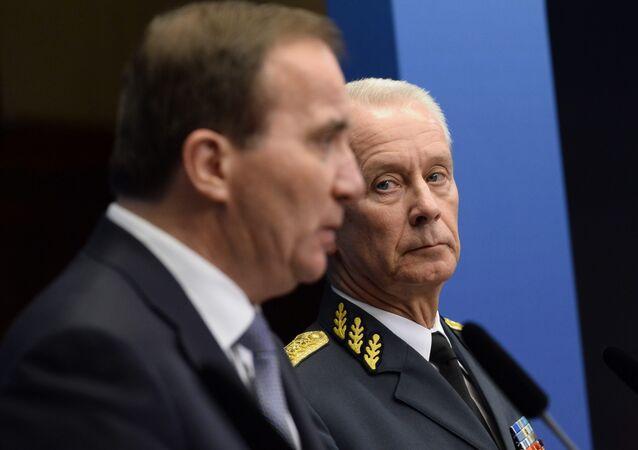 Supreme Commander Sverker Goranson, right, and Sweden's prime minister Stefan Lofven, left, talk to the media at a press conference in Stockholm Friday, Nov. 14, 2014.