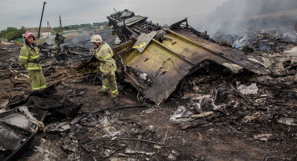 Rescuers seen at the site of the MH17 plane crash in Ukraine. File photo