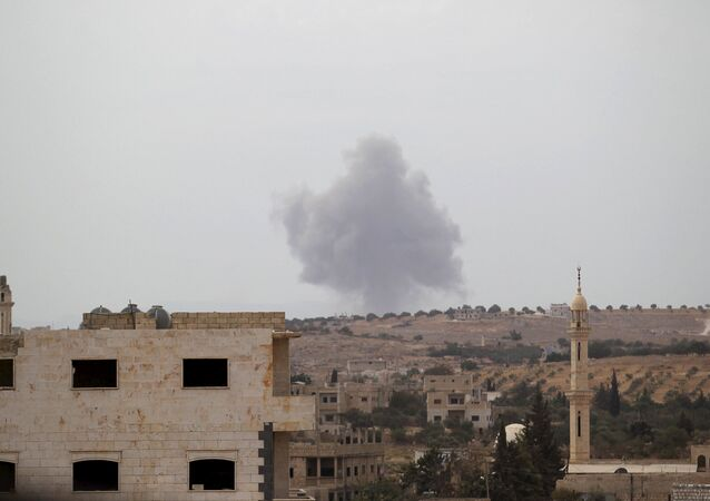 Smoke rises from a base in the southern countryside of Idlib, Syria October 1, 2015.