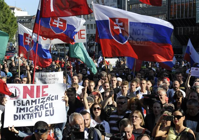 Participants hold flags and banners reading 'No Islamization, migration and dictatorship of the EU' during an anti-immigration rally organised by an initiative called Stop Islamisation of Europe and backed by the far-right People's Party-Our Slovakia on September 12, 2015 in Bratislava, Slovakia.
