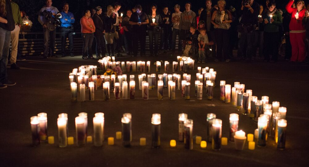 People attend a candlelight vigil in Roseburg, Oregon late on October 1, 2015, for ten people killed and seven others wounded in a shooting at a community college in the western US state of Oregon