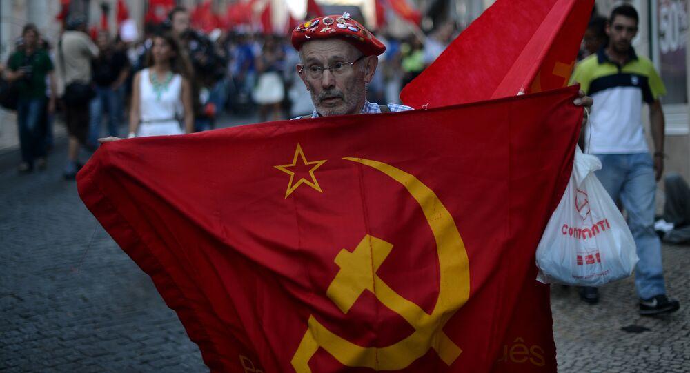 A demonstrator holds a communist flag in Lisbon.