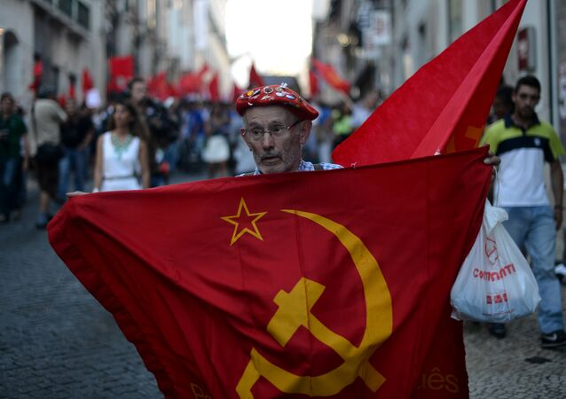 A demonstrator holds a communist flag in Lisbon.