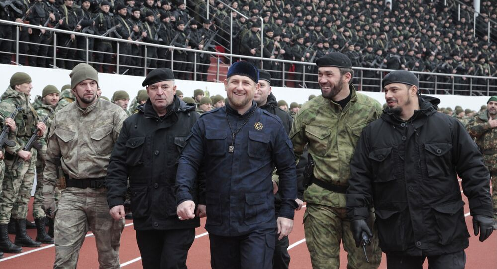 Chechnya's regional leader Ramzan Kadyrov, center, and other Chechen top commanders inspect Chechen special forces during a a rally at the Dinamo stadium in Chechen capital Grozny, Russia