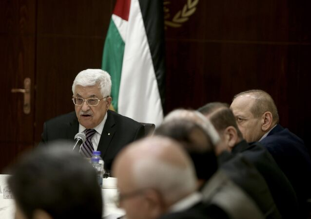 Palestinian president Mahmud Abbas (C-back) chairs a meeting of the Palestine Liberation Organisation (PLO) executive committee in the West Bank city of Ramallah