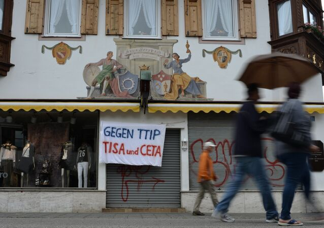 A banner reading 'Against TTIP, TiSA and CETA' hangs over the entrance of a shop in Garmisch-Partenkirchen, southern Germany