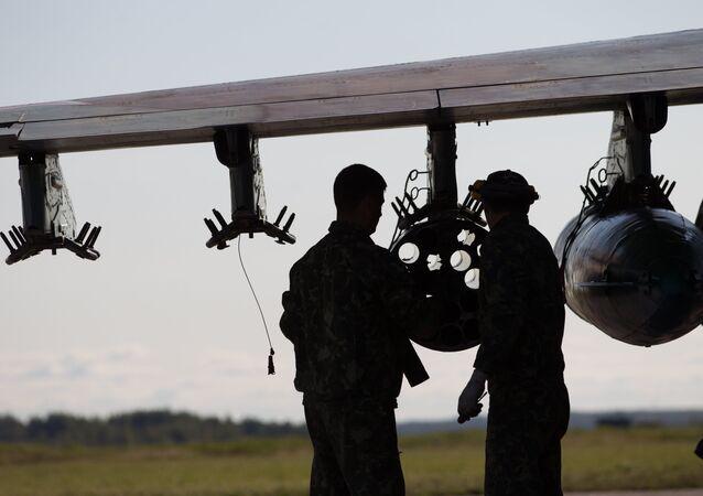 Servicemen near Su-25 aircraft
