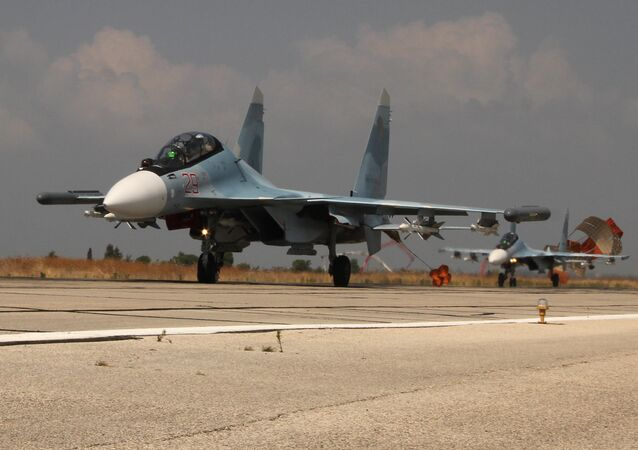 Russian Su-30 jets landing at the Hmeymim Air Base.