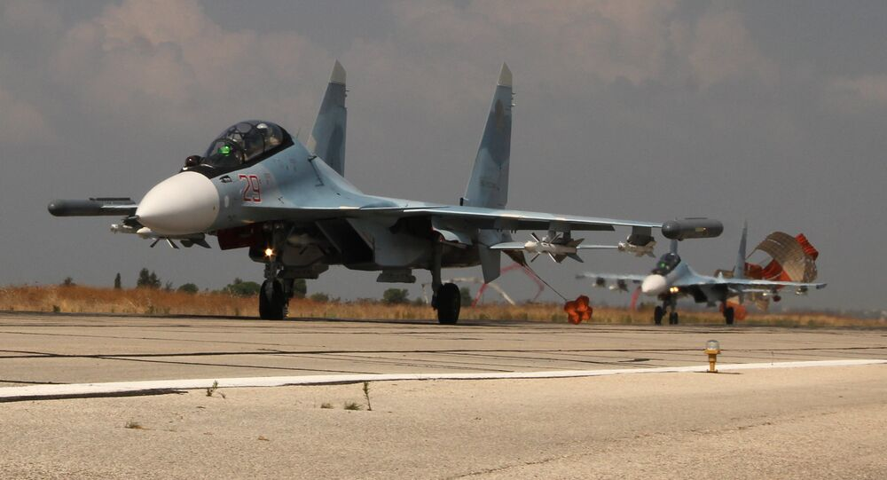 Russian Su-30 jets landing at the Hmeymim airbase, Syria