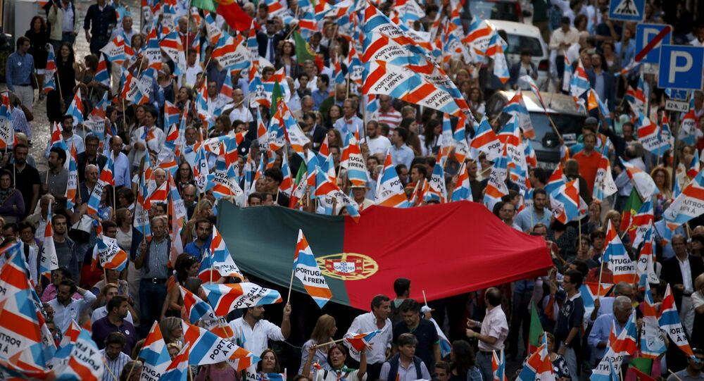 Supporters accompany Portugal's Prime Minister Pedro Passos Coelho and Deputy Prime Minister Paulo Portas during an election campaign event in Lisbon, Portugal, October 2, 2015