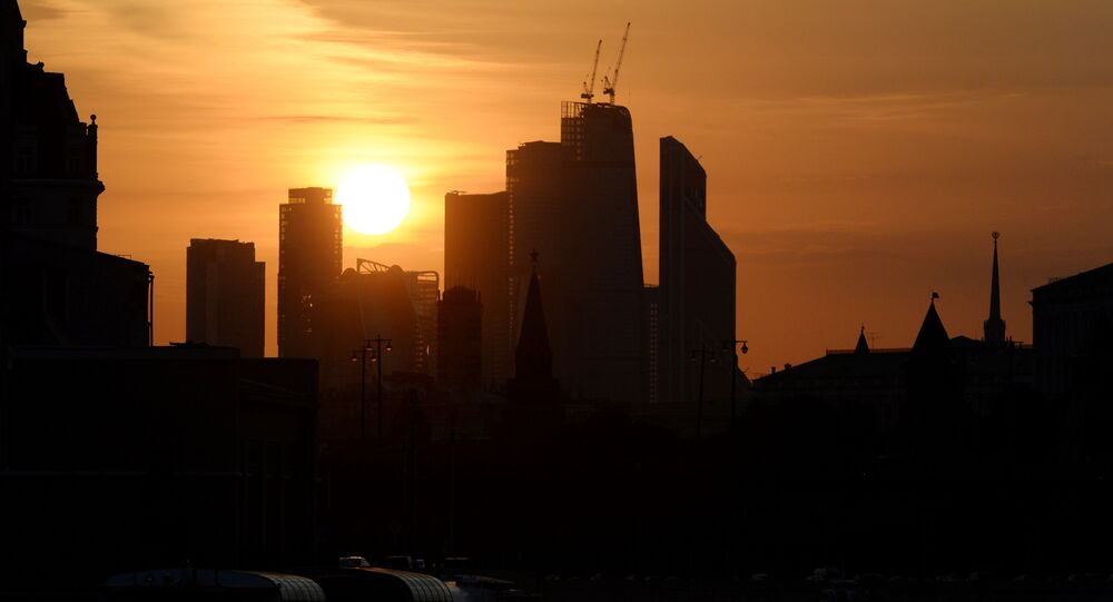 The sun sets behind the central Moscow skyline on September 18, 2015