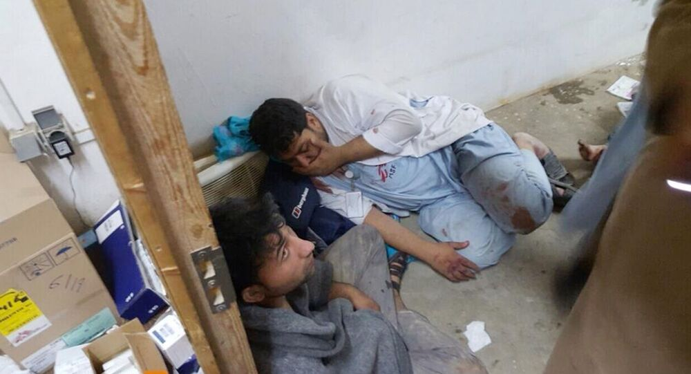 Injured Doctors Without Borders staff are seen after explosions near their hospital in the northern Afghan city of Kunduz, Saturday, Oct. 3, 2015