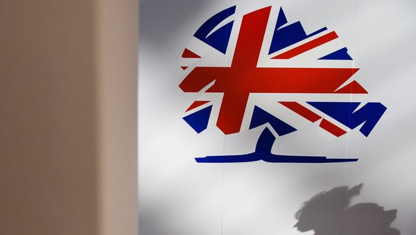 The Conservative party logo is displayed on the first day of the annual Conservative party conference in Manchester, north west England, on October 4, 2015. - Sputnik International