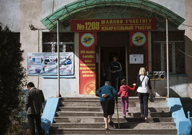 Electors go to a ballot station in Bishkek where elections to Kyrgyzstan's one-house parliament are taking place.