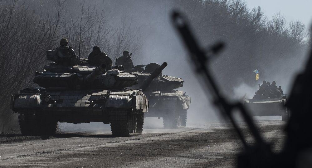 File photo of Ukrainian troops ride on tanks near Artemivsk, eastern Ukraine, Tuesday, Feb. 24, 2015