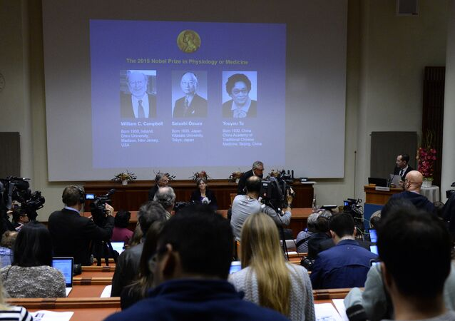 The portraits of the winners of the Nobel Medicine Prize 2015 (L-R) Irish-born William Campbell, Satoshi Omura of Japan and China's Youyou Tu are displayed on a screen during a press conference of the Nobel Committee to announce the winners of the 2015 Nobel Medicine Prize on October 5, 2015 at the Karolinska Institutet in Stockholm, Sweden