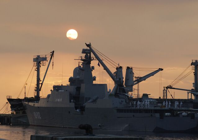 Vietnamese sailors gather on the deck of Vietnamese frigate Ly Thai To (HQ-012) as the sun sets at Manila bay, Philippines Tuesday, Nov. 25, 2014