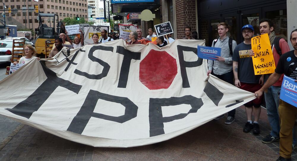 Protestors call for the rejection of the Trans-Pacific Partnership trade deal under negotiation in Atlanta, Georgia on October 1, 2015