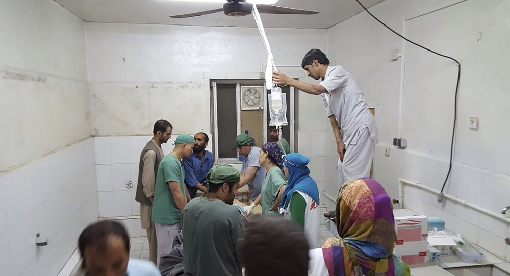 Afghan (MSF) surgeons work inside a Medecins Sans Frontieres (MSF) hospital after an air strike in the city of Kunduz, Afghanistan in this October 3, 2015