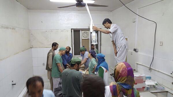 Afghan (MSF) surgeons work inside a Medecins Sans Frontieres (MSF) hospital after an air strike in the city of Kunduz, Afghanistan in this October 3, 2015 - Sputnik International