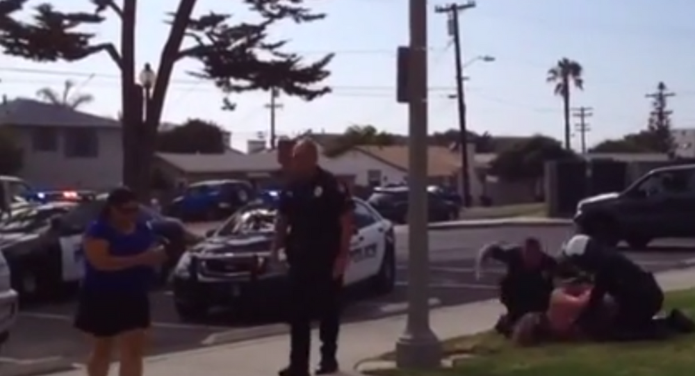 Cops Beat a Woman While Her Children Watch