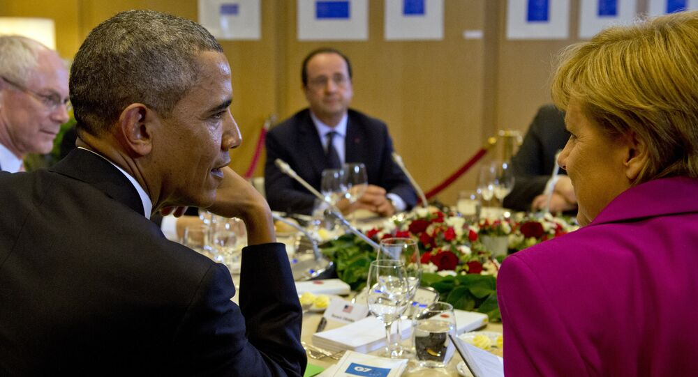 US President Barack Obama, President of the European Council Herman van Rompuy, France's President Francois Hollande, Germany's Chancellor Angela Merkel attend a working dinner at the G7 summit at the European Council headquarters on June 4, 2014 in Brussels