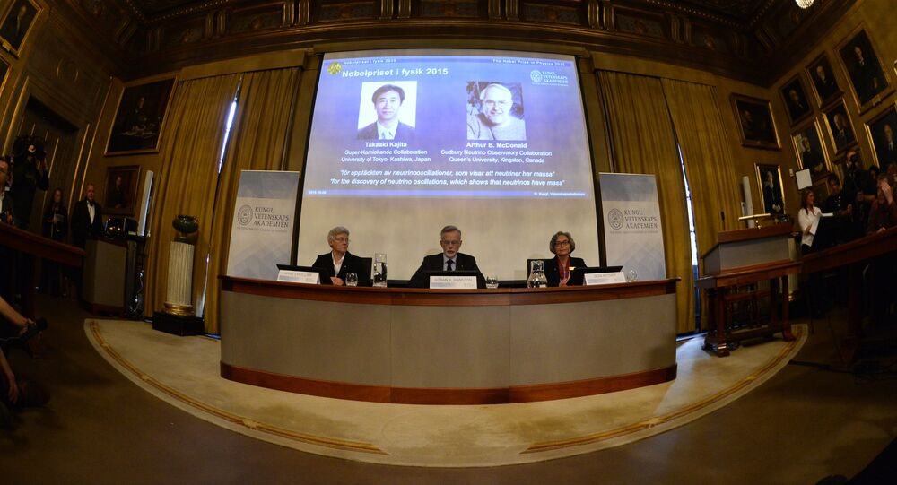 Anne L'Huillier, member of the Nobel Committee for Physics, Goran K Hansson, Permanent Secretary of the Royal Swedish Academy of Sciences, and Olga Botner, member of the Nobel Committee for Physics, sit in front of a screen displaying the winners of the Nobel Prize in Physics 2015 Takaaki Kajita (L) and Arthur B McDonald during a press conference of the Nobel Committee to announce the winners of the 2015 Nobel Prize in Physics on October 6, 2015 at the Swedish Academy of Sciences in Stockholm, Sweden
