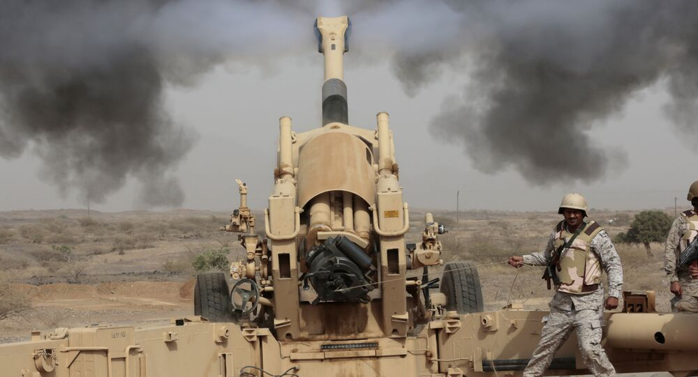 In this Monday, April 20, 2015, file photo, Saudi soldiers fire artillery toward three armed vehicles approaching the Saudi border with Yemen in Jazan, Saudi Arabia.
