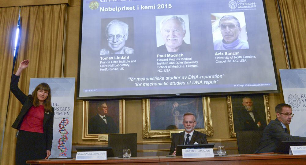Professors Sara Snogerup Linse, Goran K. Hansson and Claes Gustafsson, members of the Nobel Assembly, talk to the media at a news conference at the Royal Swedish Academy in Stockholm October 7, 2015