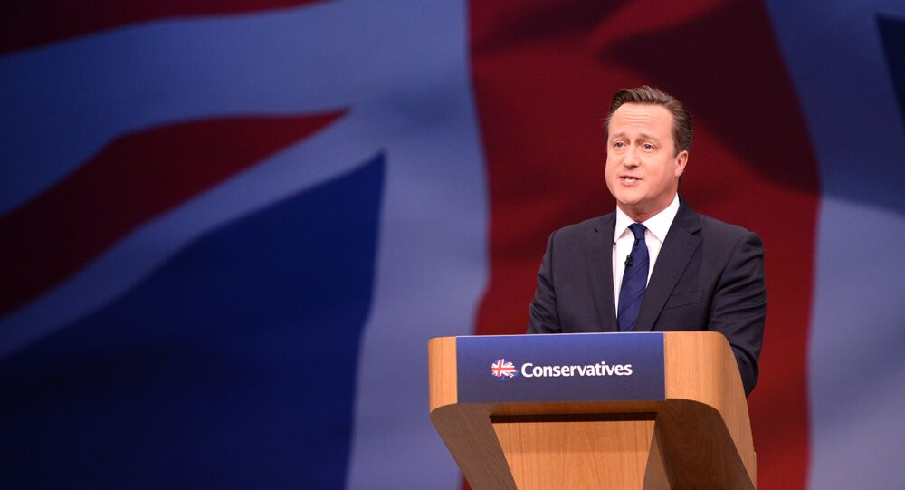 Britain's Prime Minister David Cameron gestures as he delivers his keynote address at the annual Conservative Party Conference in Manchester, Britain October 7, 2015.