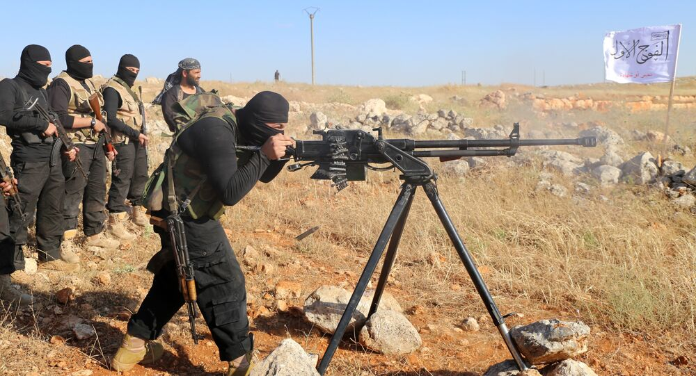 Rebel fighters from the First Battalion under the Free Syrian Army take part in a military training on June 10, 2015, in the rebel-held countryside of the northern city of Aleppo