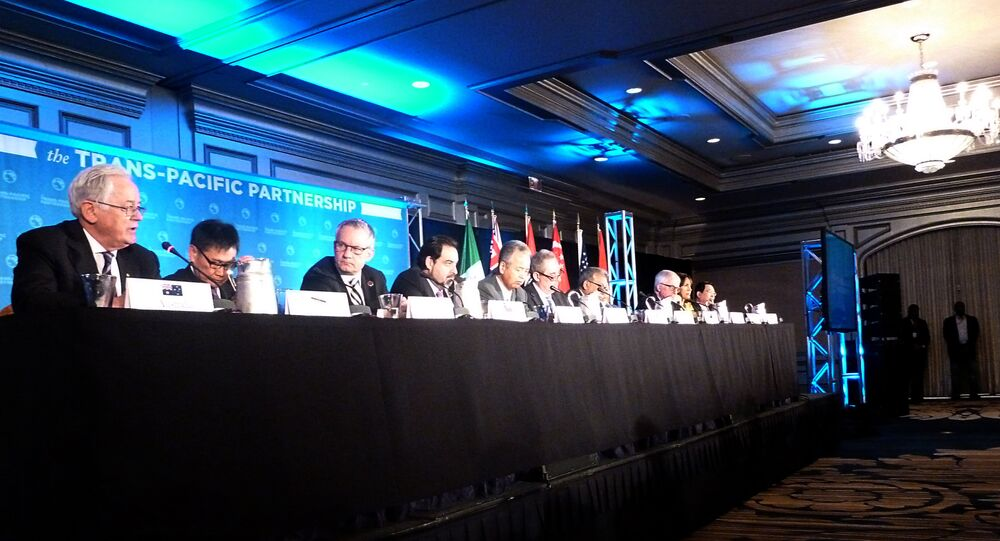 Delegates attending the Trans-Pacific Partnership(TPP) talks hold a press conference October 5, 2012 in Atlanta, Georgia