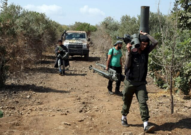 Rebel fighters carry TOW missile launcher outside Damascus suburb, file photo.