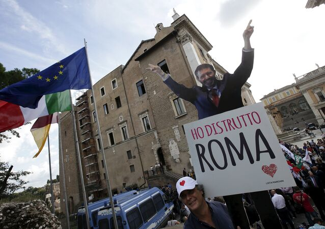 A man holds a cardboard cut-out of Rome Mayor Ignazio Marino reading I destroyed Rome during a protest in front of Rome's city hall, Campidoglio (the Capitoline hill), October 8, 2015