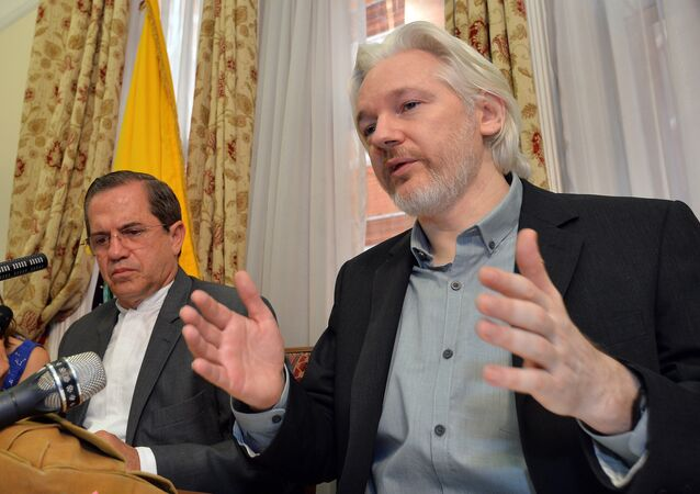 In this Aug. 18, 2014, file photo, Ecuador's Foreign Minister Ricardo Patino, left, and WikiLeaks founder Julian Assange speak during a news conference inside the Ecuadorian Embassy in London.